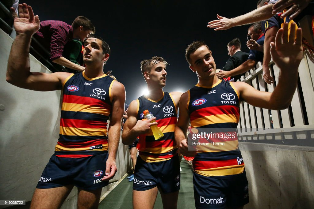 Myles Poholke, Jordan Galluci and Taylor Walker of the Crows walk down the tunnel during the round five AFL match between the Sydney Swans and the Adelaide Crows at Sydney Cricket Ground on April 20, 2018 in Sydney, Australia.