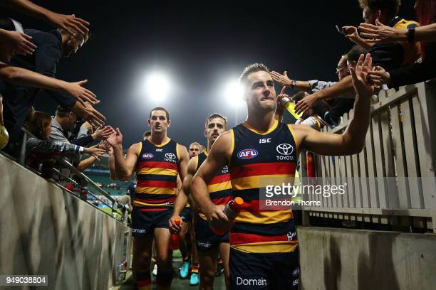 Myles Poholke Jordan Galluci and Taylor Walker of the Crows walk down the tunnel during the round five AFL match between the Sydney Swans and the...