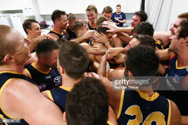 Myles Poholke of the Crows celebrates with team mates in the dressing room during the round five AFL match between the Sydney Swans and the Adelaide...