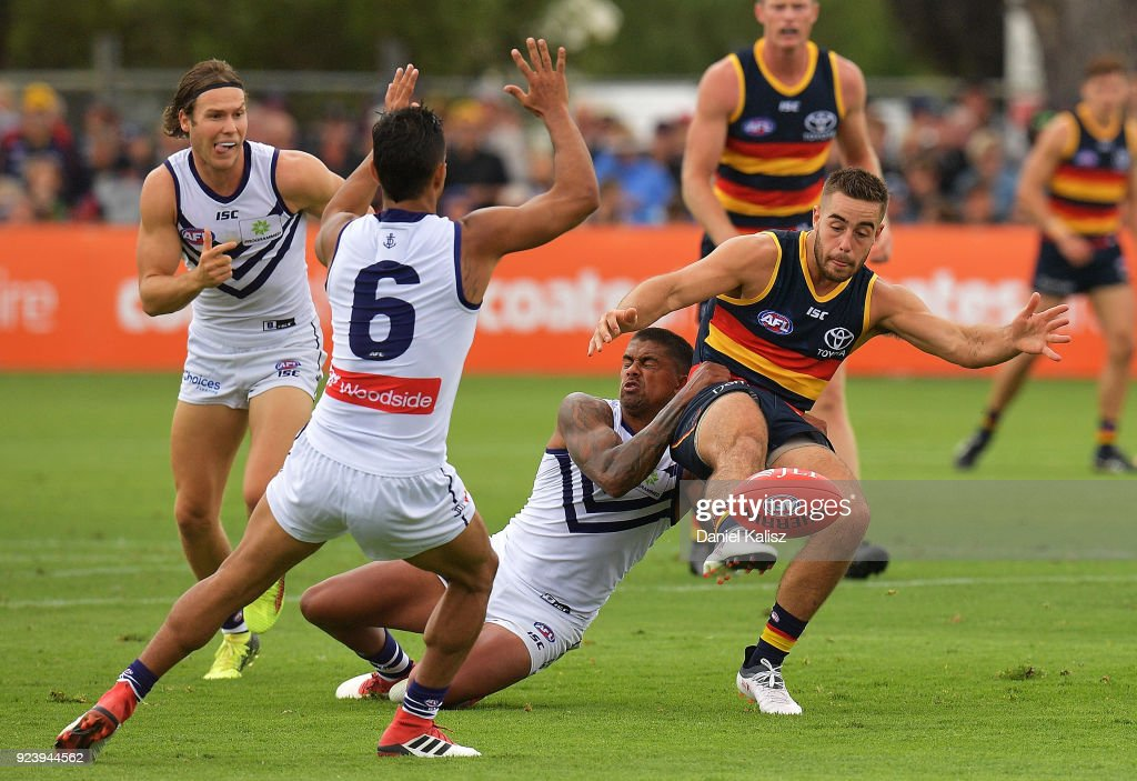 Myles Poholke of the Crows kicks the ball during the JLT Community Series AFL match between the Adelaide Crows and the Fremantle Dockers at Strathalbyn Oval on February 25, 2018 in Adelaide, Australia.
