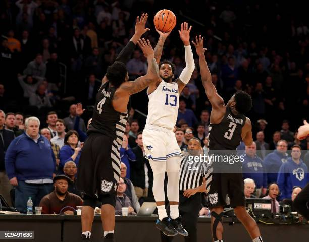 Myles Powell of the Seton Hall Pirates attempt a last second shot as Tyler Wideman and Kamar Baldwin of the Butler Bulldogs defend during...