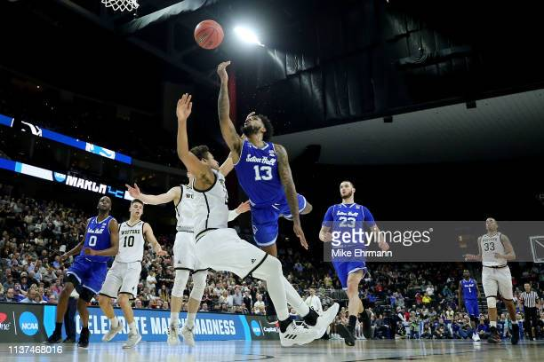 Myles Powell of the Seton Hall Pirates attempts a shot while being guarded by Keve Aluma of the Wofford Terriers in the second half during the first...
