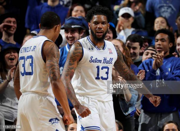 Myles Powell of the Seton Hall Pirates celebrates with teammate Shavar Reynolds after he draws the foul in the first half against the Marquette...