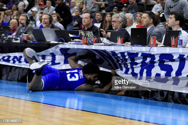 Myles Powell of the Seton Hall Pirates dives into the press table in the second half against the Wofford Terriers during the first round of the 2019...