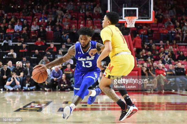 Myles Powell of the Seton Hall Pirates dribbles by Anthony Cowan Jr. #1 of the Maryland Terrapins during a college basketball game at the XFinity...