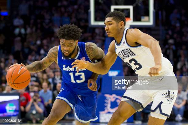 Myles Powell of the Seton Hall Pirates dribbles the ball against Jermaine Samuels of the Villanova Wildcats in the first half at the Wells Fargo...