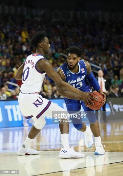 Myles Powell of the Seton Hall Pirates drives against Marcus Garrett of the Kansas Jayhawks in the first half during the second round of the 2018...