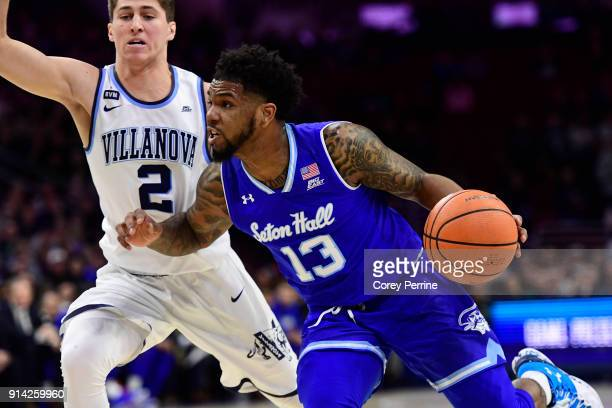 Myles Powell of the Seton Hall Pirates drives to the basket against Collin Gillespie of the Villanova Wildcats during the first half at the Wells...