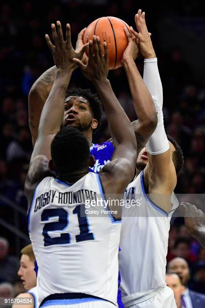 Myles Powell of the Seton Hall Pirates eyes the rim while being pressured by Dhamir CosbyRoundtree and Jalen Brunson of the Villanova Wildcats during...