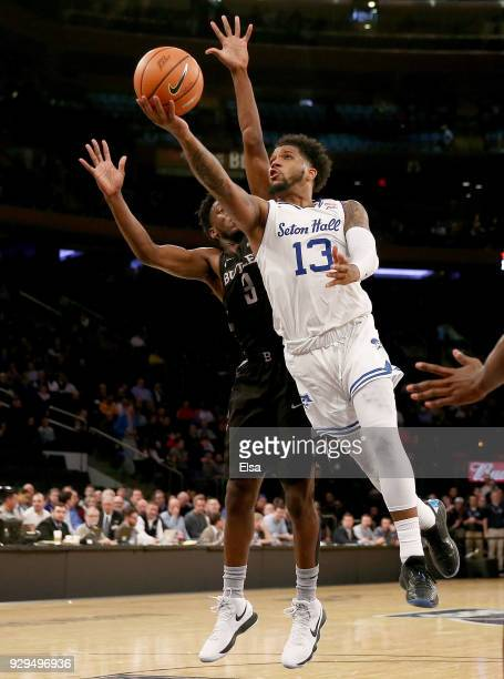 Myles Powell of the Seton Hall Pirates heads for the net as Kamar Baldwin of the Butler Bulldogs defends in the second half during quarterfinals of...