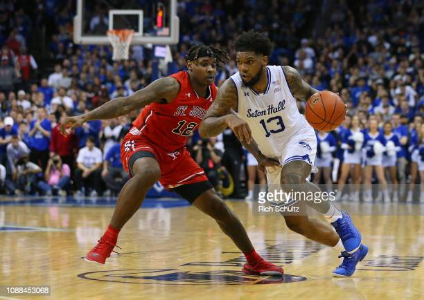Myles Powell of the Seton Hall Pirates in action against Bryan Trimble Jr #12 of the St John's Red Storm during a game at Prudential Center on...