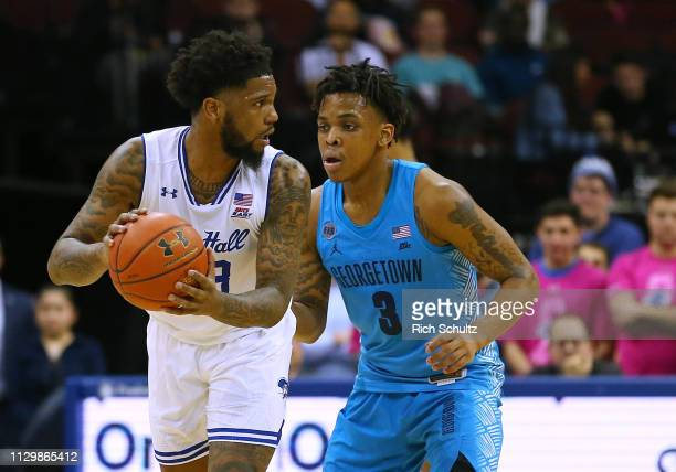 Myles Powell of the Seton Hall Pirates in action against James Akinjo of the Georgetown Hoyas during a game at Prudential Center on February 13 2019...