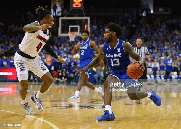 Myles Powell of the Seton Hall Pirates in action against Khwan Fore of the Louisville Cardinals during a college basketball game at Prudential Center...