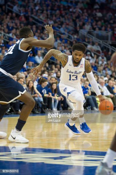 Myles Powell of The Seton Hall Pirates moves the ball as Dhamir CosbyRoundtree of The Villanova Wildcats defends on February 28 2018 at Prudential...