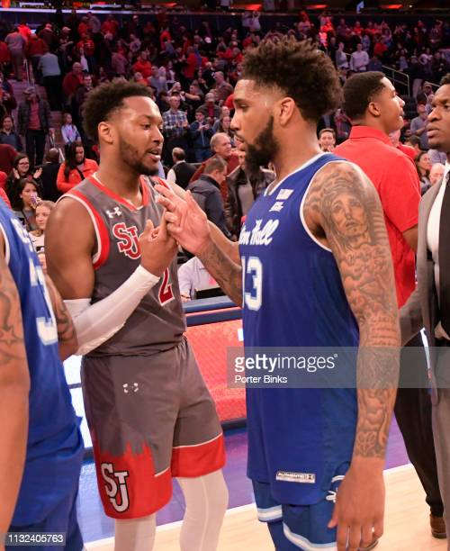 Myles Powell of the Seton Hall Pirates shakes hands with Shamorie Ponds of the St John's Red Storm after their game at Madison Square Garden on...
