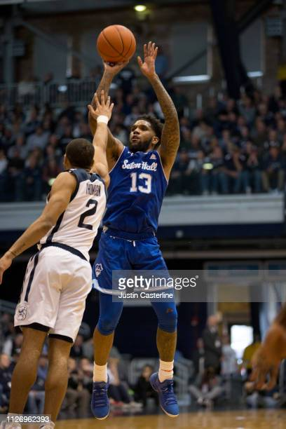 Myles Powell of the Seton Hall Pirates shoots the ball while being defended by Aaron Thompson of the Butler Bulldogs during the second half at Hinkle...