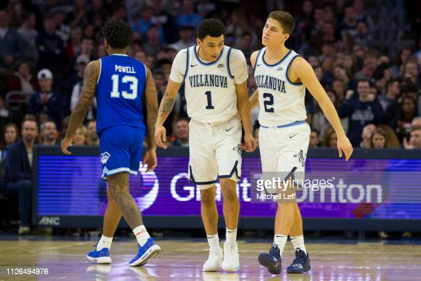 Myles Powell of the Seton Hall Pirates walks to the bench along with Jahvon Quinerly and Collin Gillespie of the Villanova Wildcats at the Wells...