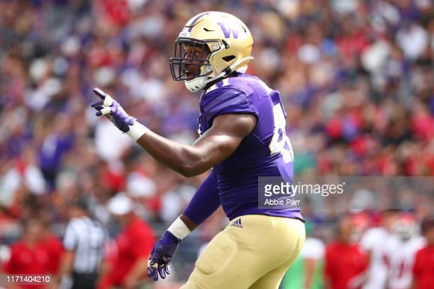Myles Rice of the Washington Huskies celebrates in the third quarter against the Eastern Washington Eagles during their game at Husky Stadium on...