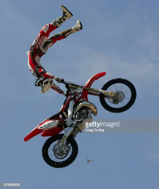 Myles Richmond of Cherry Valley California wows the Huntington Beach crowd with an incredible aerial display during the Freestyle Motocross event at...