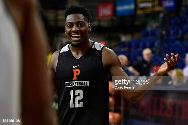 Myles Stephens of the Princeton Tigers laughs with teammates during a shoot around practice in preparation for the Ivy League tournament at The...
