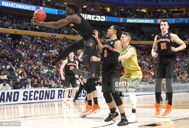Myles Stephens of the Princeton Tigers rebounds the ball against the Notre Dame Fighting Irish during the first round of the 2017 NCAA Men's...