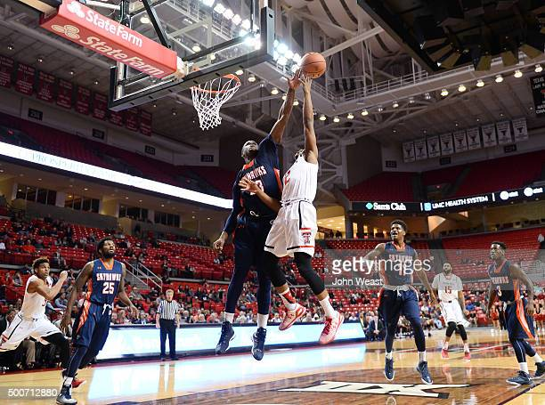 Myles Taylor of the TennesseeMartin Skyhawks blocks the shot of Devon Thomas of the Texas Tech Red Raiders during the game on December 09 2015 at...