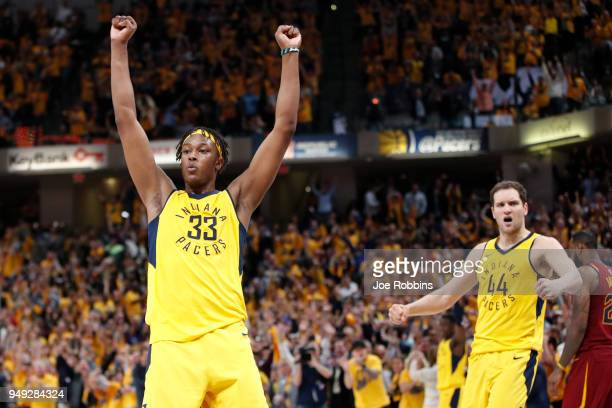 Myles Turner and Bojan Bogdanovic of the Indiana Pacers celebrate at the end of game three of the NBA Playoffs against the Cleveland Cavaliers at...