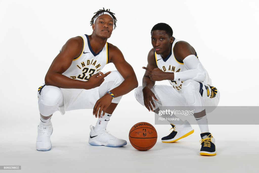 Myles Turner #33 and Victor Oladipo #4 of the Indiana Pacers poses for a portrait during the Pacers Media Day at Bankers Life Fieldhouse on September 25, 2017 in Indianapolis, Indiana.