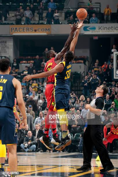 Myles Turner of the Indiana Pacers and Dewayne Dedmon of the Atlanta Hawks reach for the opening tipoff during the game on February 23 2018 at...