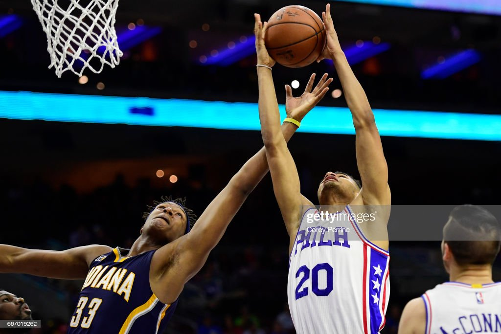Myles Turner #33 of the Indiana Pacers and Timothe Luwawu-Cabarrot #20 of the Philadelphia 76ers fight for the ball during the fourth quarter at the Wells Fargo Center on April 10, 2017 in Philadelphia, Pennsylvania. The Pacers won 120-111.
