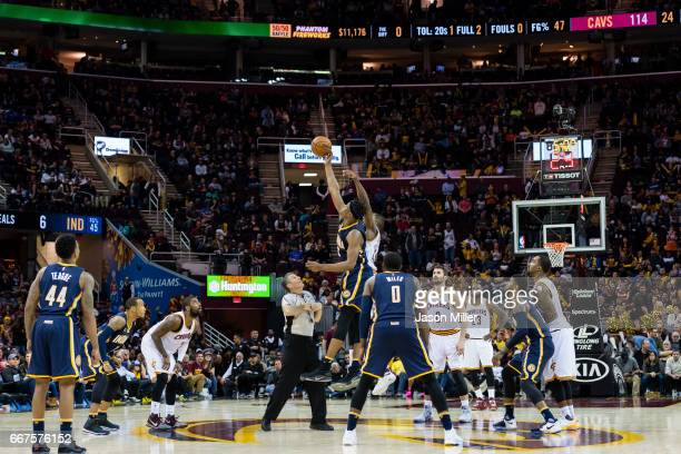 Myles Turner of the Indiana Pacers and Tristan Thompson of the Cleveland Cavaliers jump for the tipoff at the beginning of the double overtime period...