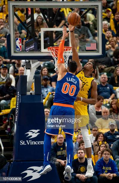 Myles Turner of the Indiana Pacers blocks a basket attempt made by Enes Kanter of the New York Knicks during the second half of the game at Bankers...