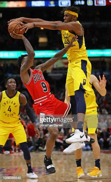 Myles Turner of the Indiana Pacers blocks a last second shot by Antonio Blakeney of the Chicago Bulls at the United Center on November 2 2018 in...