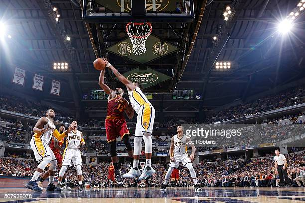 Myles Turner of the Indiana Pacers blocks a shot against Tristan Thompson of the Cleveland Cavaliers in the second half of the game at Bankers Life...
