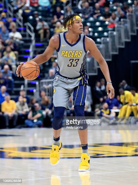 Myles Turner of the Indiana Pacers dribbles the ball against the Chicago Bulls at Bankers Life Fieldhouse on December 4 2018 in Indianapolis Indiana...