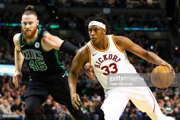 Myles Turner of the Indiana Pacers dribbles the ball past Aron Baynes of the Boston Celtics during a game at TD Garden on March 11 2018 in Boston...