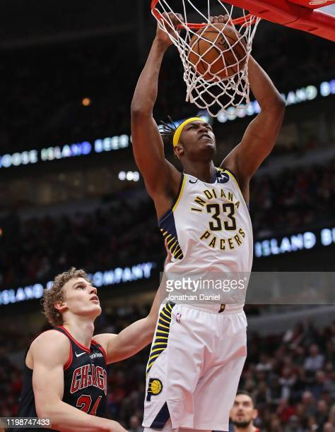 Myles Turner of the Indiana Pacers dunks over Lauri Markkanen of the Chicago Bulls at the United Center on January 10, 2020 in Chicago, Illinois....