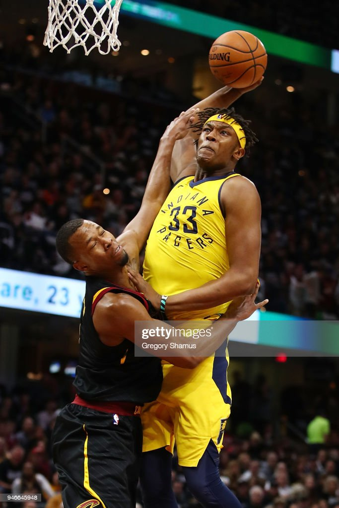 Myles Turner #33 of the Indiana Pacers dunks past Rodney Hood #1 of the Cleveland Cavaliers during the first half in Game One of the Eastern Conference Quarterfinals during the 2018 NBA Playoffs at Quicken Loans Arena on April 15, 2018 in Cleveland, Ohio.