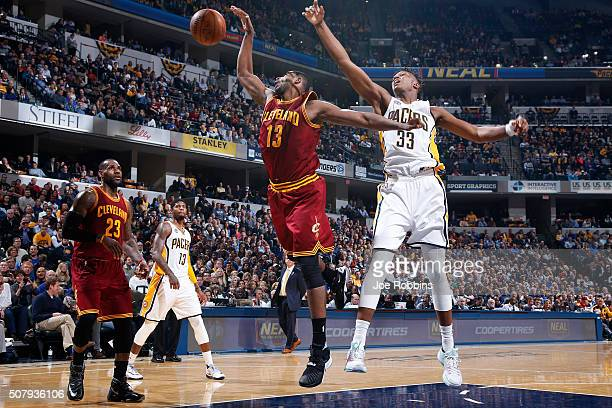 Myles Turner of the Indiana Pacers fights for a rebound against Tristan Thompson of the Cleveland Cavaliers in the first half of the game at Bankers...