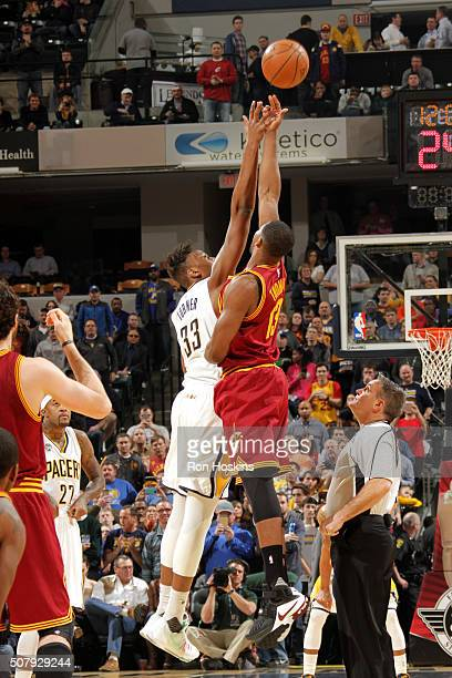 Myles Turner of the Indiana Pacers fights for the jump ball against Tristan Thompson of the Cleveland Cavaliers during the game on February 1 2016 at...