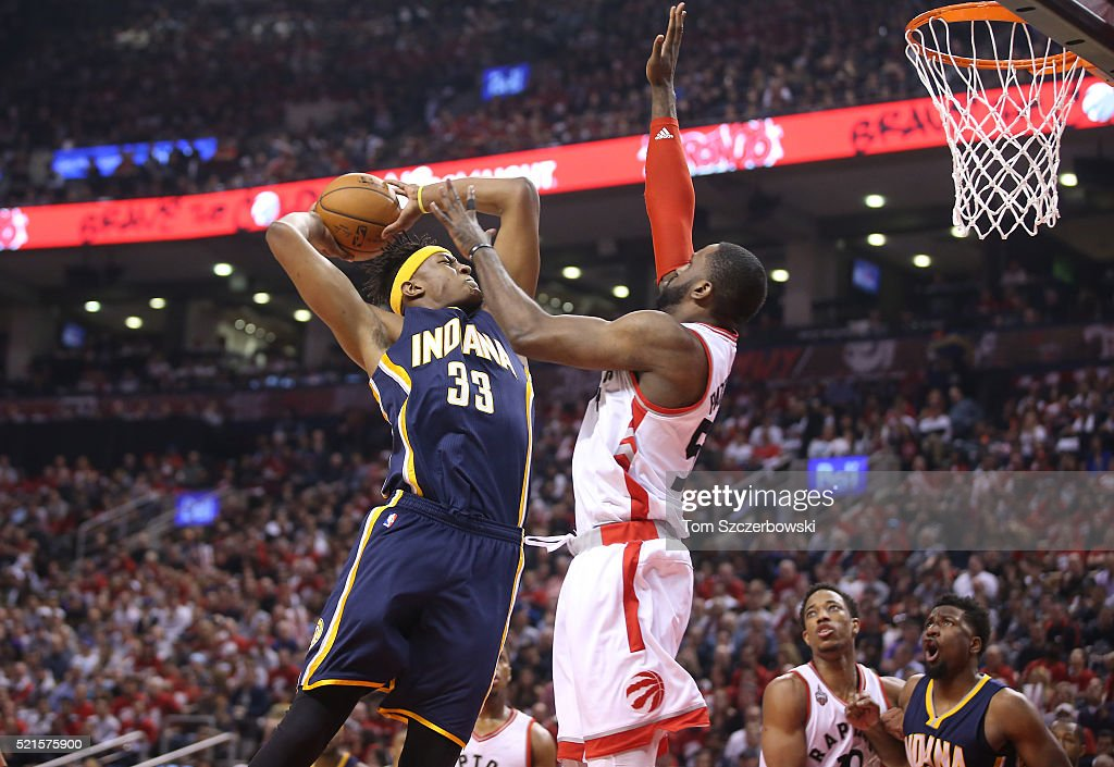 Myles Turner #33 of the Indiana Pacers goes up to shoot against Patrick Patterson #54 of the Toronto Raptors in Game One of the Eastern Conference Quarterfinals during the 2016 NBA Playoffs on April 16, 2016 at the Air Canada Centre in Toronto, Ontario, Canada.