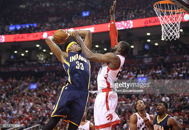 Myles Turner of the Indiana Pacers goes up to shoot against Patrick Patterson of the Toronto Raptors in Game One of the Eastern Conference...