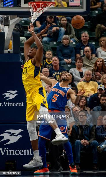 Myles Turner of the Indiana Pacers reacts after blocking a shot thrown by Courtney Lee of the New York Knicks during the first half of the game at...