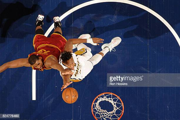 Myles Turner of the Indiana Pacers shoots a layup during the game against Tristan Thompson of the Cleveland Cavaliers on February 1 2016 at Bankers...