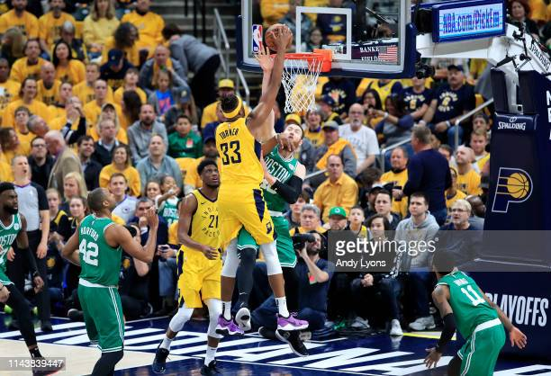 Myles Turner of the Indiana Pacers shoots the ball while defended by Aron Baynes of the Boston Celtics in game three of the first round of the 2019...