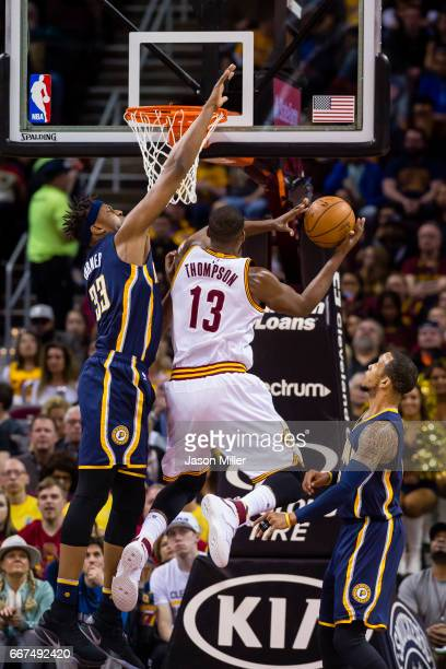 Myles Turner of the Indiana Pacers tries to block Tristan Thompson of the Cleveland Cavaliers during the first half at Quicken Loans Arena on April 2...