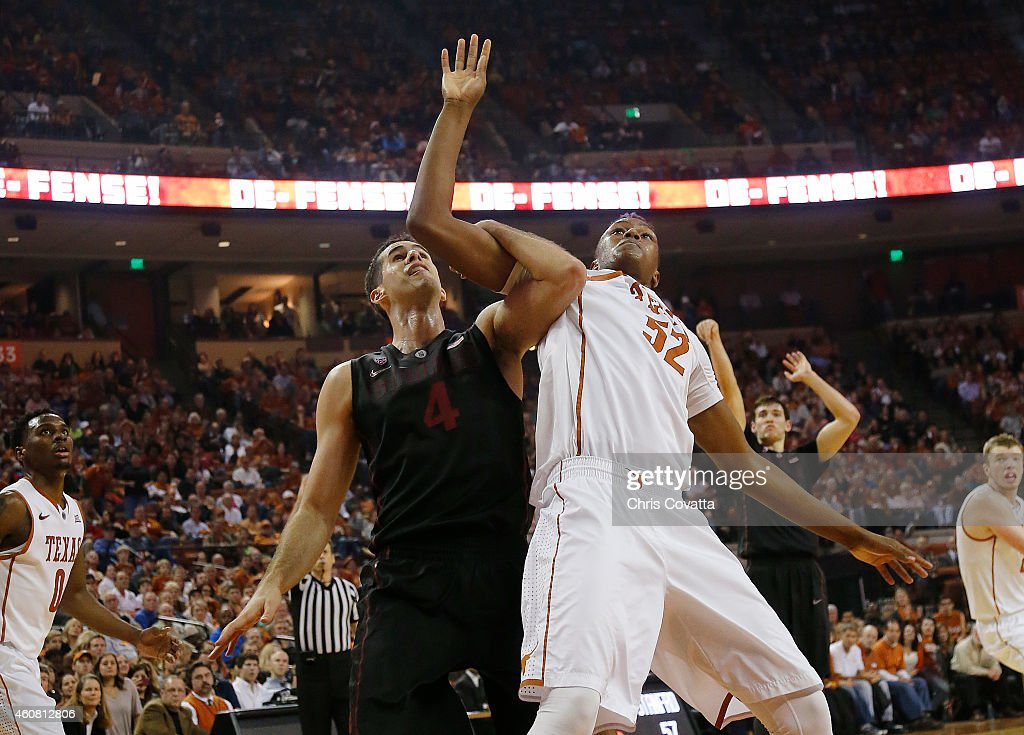 Myles Turner #52 of the Texas Longhorns battles Stefan Nastic #4 of the Stanford Cardinal for position at the Frank Erwin Center on December 23, 2014 in Austin, Texas.