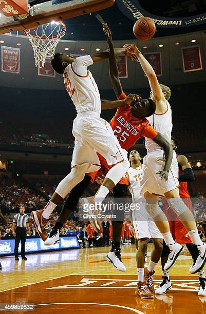 Myles Turner of the Texas Longhorns fouls Kevin Hervey of the TexasArlington Mavericks while attempting to block a shot at the Frank Erwin Center on...