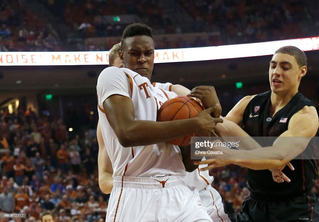 Myles Turner #52 of the Texas Longhorns grabsa rebound from Reid Travis #22 of the Stanford Cardinal at the Frank Erwin Center on December 23, 2014 in Austin, Texas.