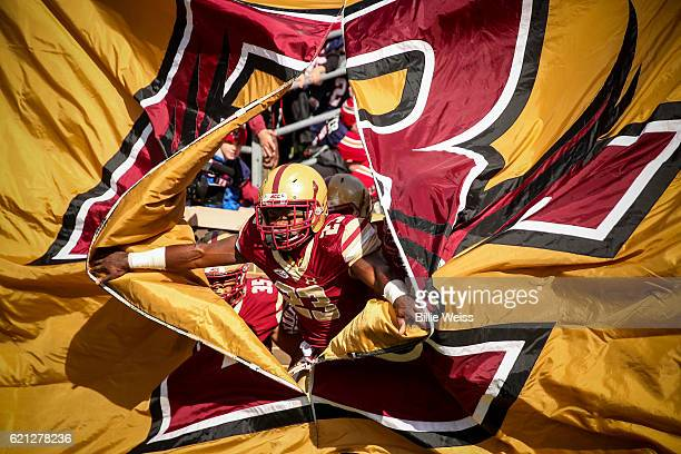 Myles Willis of Boston College breaks through a flag as the team is introduced before a game against Louisville at Alumni Stadium on November 5 2016...